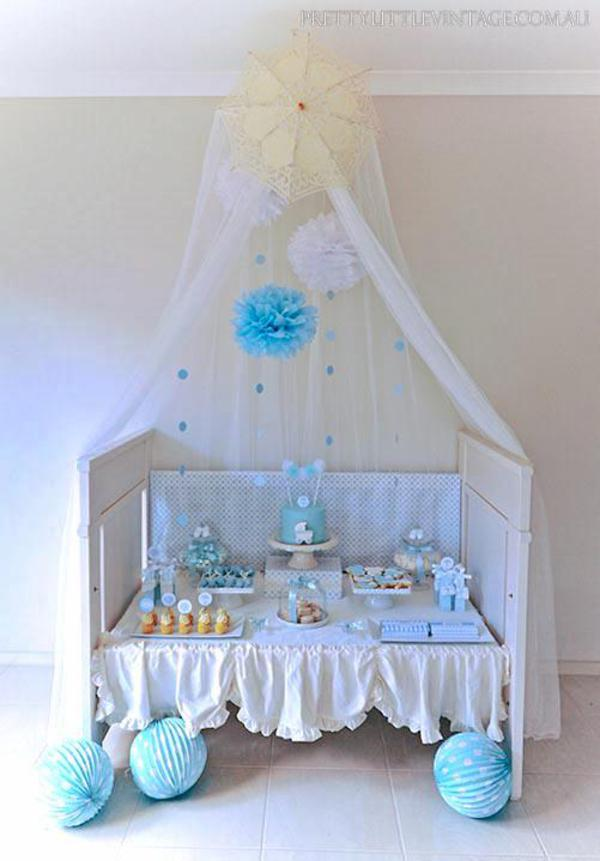 Kara 39 s party ideas showered from above rain boy baby for Baby cot decoration