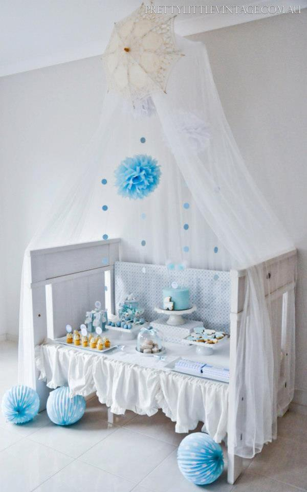 Kara 39 s party ideas showered from above rain boy baby for Above the crib decoration ideas