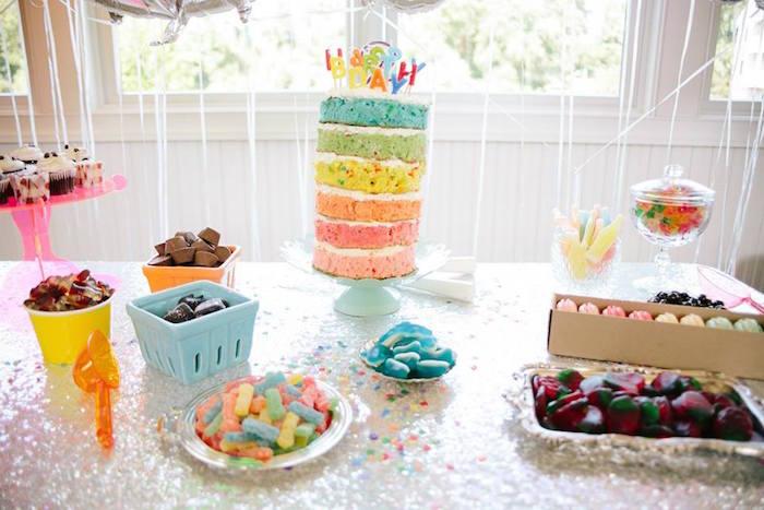 dessert table goodies from a rainbows balloons confetti birthday party via karas party ideas