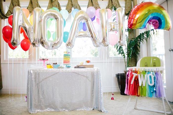dessert table highchair from a rainbows balloons confetti birthday party via karas party