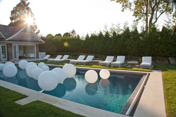 Kara 39 s party ideas white balloons placed in water from a for Garden pool party ideas