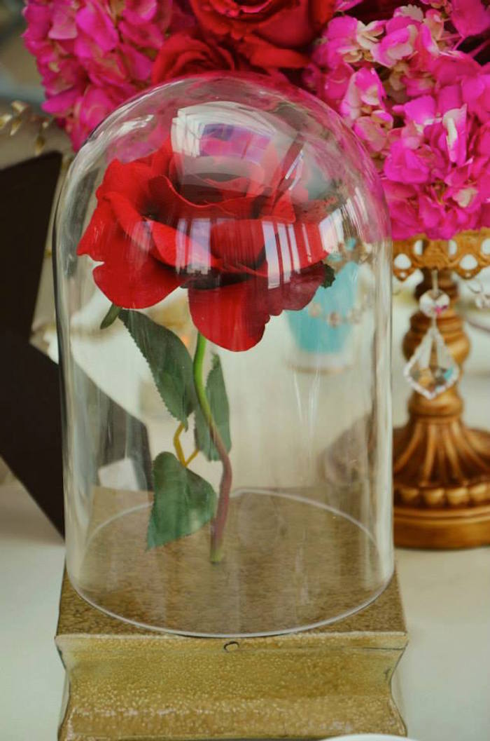 beauty and the beast table centerpiece at a fairytale princess baby