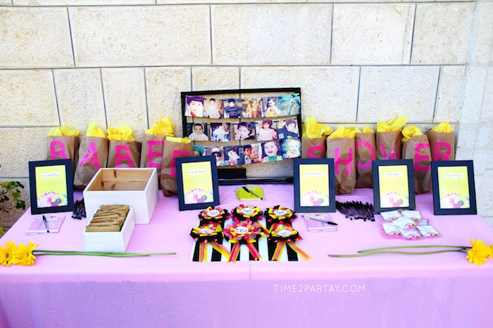 Game Favor Table From A Mommy To Bee Themed Baby Shower Via Karas Party Ideas