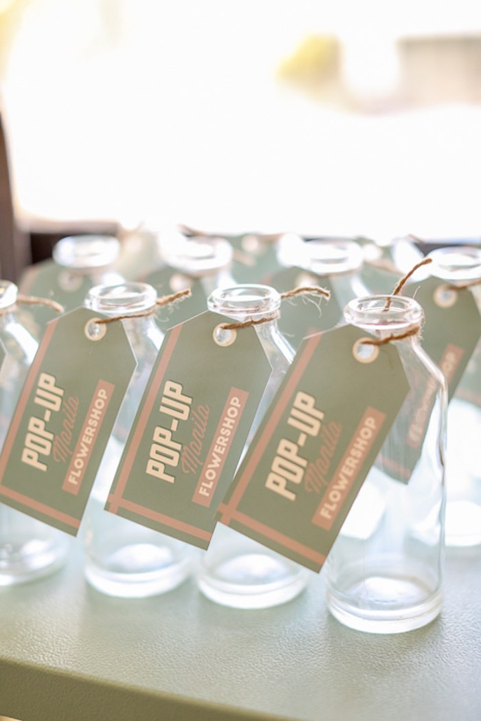 kara u0026 39 s party ideas vintage glass bottles from a vintage hipster pop up flower shop party via