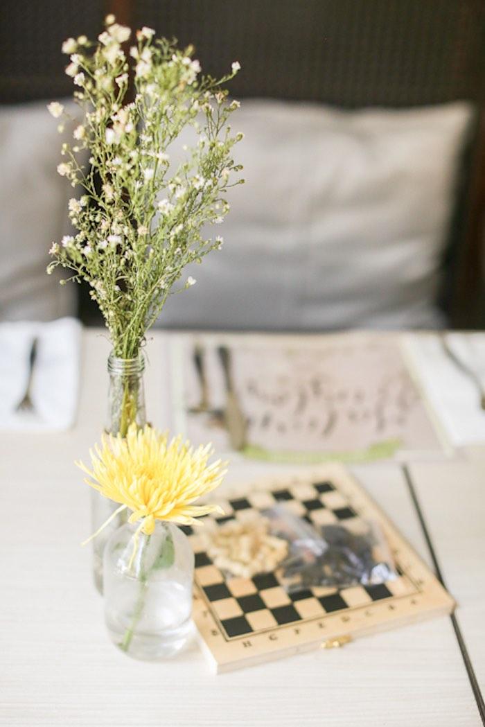 kara u0026 39 s party ideas floral arrangements   checkerboard centerpiece from a vintage hipster pop up