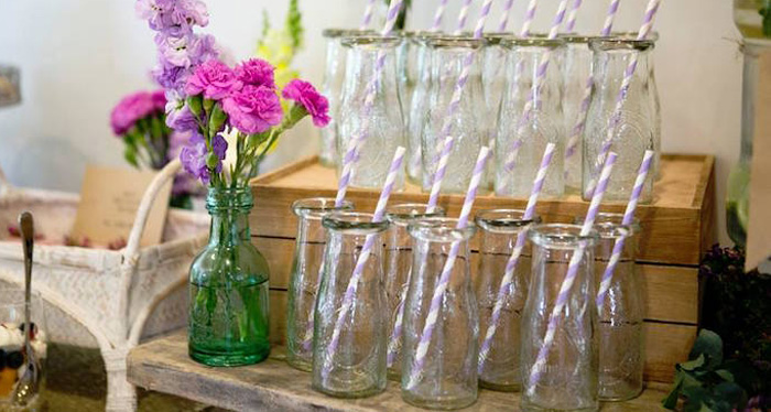 Glass Milk Drink Bottles From A Boho Chic Baby Shower Via Karas Party Ideas
