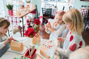 Girls Decorating Gingerbread Houses at a Gingerbread House Decorating Party via Kara's Party Ideas KarasPartyIdeas.com (15)