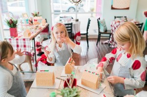 Girls Decorating Gingerbread Houses at a Gingerbread House Decorating Party via Kara's Party Ideas KarasPartyIdeas.com (14)