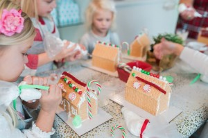 Girls Decorating Gingerbread Houses at a Gingerbread House Decorating Party via Kara's Party Ideas KarasPartyIdeas.com (13)