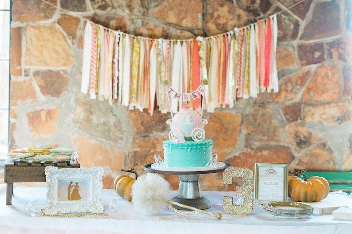 cake table from a cinderella birthday party via karas party ideas karaspartyideascom