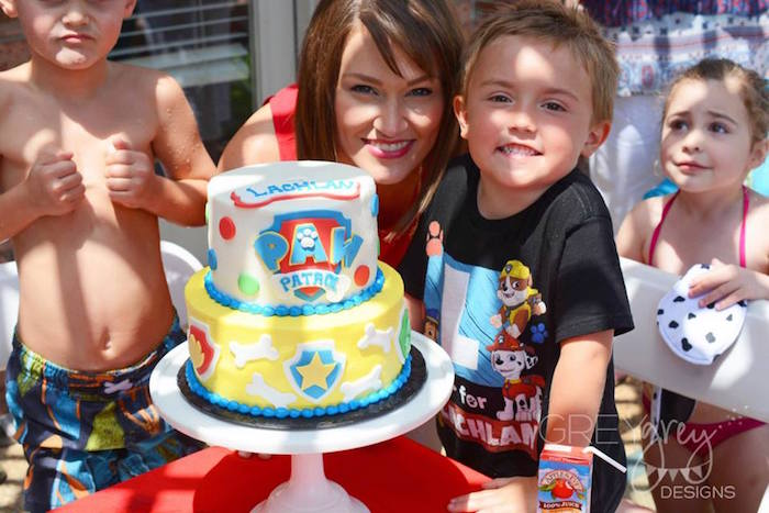 Birthday boy with his cake from a Paw Patrol Birthday Party via Kara's Party Ideas | KarasPartyIdeas.com (27)