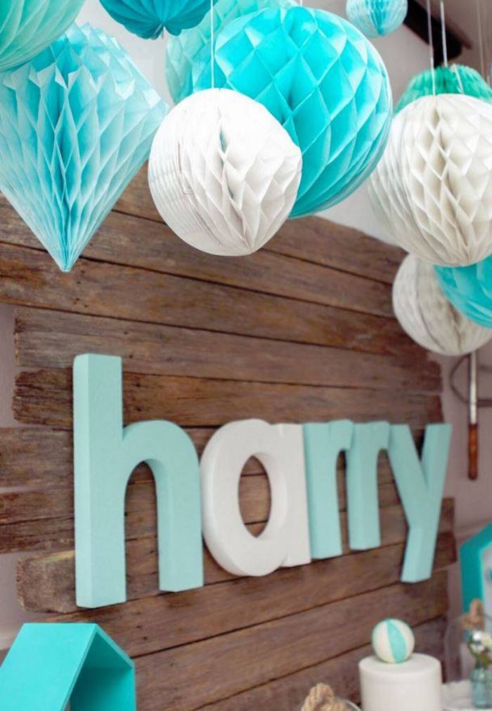 Hanging Honeycomb Decorations Backdrop From A Rustic Beach Ball Birthday Party Via Karas Ideas