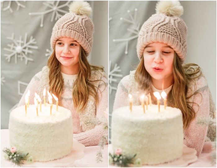 Birthday girl blowing out her candles from a Winter Wonderland Birthday Party via Kara's Party Ideas KarasPartyIdeas.com (9)