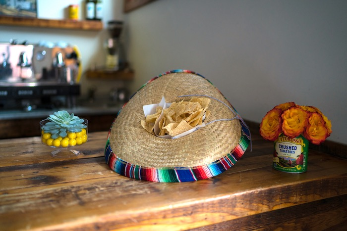 Guest Table + Chips Placed in a Sombrero from a Colorful First Birthday Fiesta via Kara's Party Ideas KarasPartyIdeas.com (17)