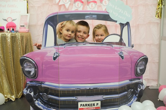 Guests Posing in a Car Photo Booth from a Girly Race Car Birthday Party via Kara's Party Ideas | KarasPartyIdeas.com (39)