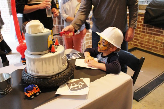 Birthday Boy getting ready to blow out the candles from a Modern Construction Birthday Party via Kara's Party Ideas | KarasPartyIdeas.com The Place for All Things Party! (19)