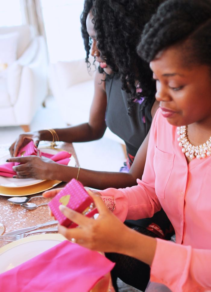 Gals Exchanging Bracelets at a Pink + Gold Galentines Valentines Party via Kara's Party Ideas | KarasPartyIdeas.com | The Place for All Things Party! (21)