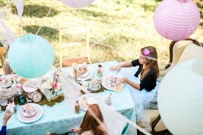 Guests Dining at a Shabby Chic Alice In Wonderland Birthday Party via Kara's Party Ideas KarasPartyIdeas.com (7)