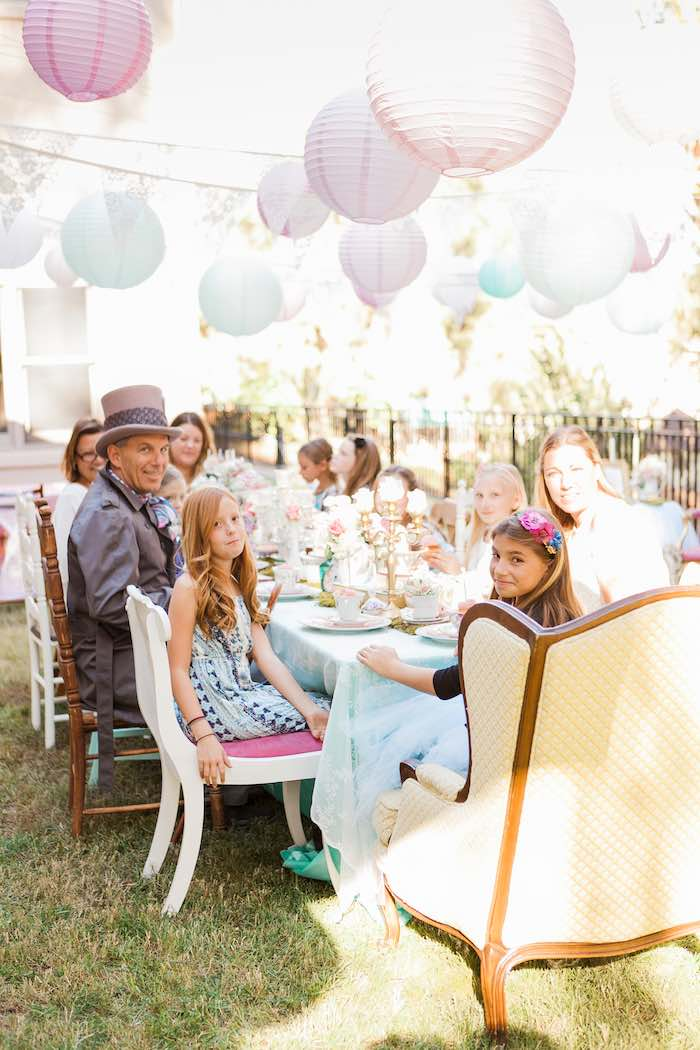 Guests Dining at a Shabby Chic Alice In Wonderland Birthday Party via Kara's Party Ideas KarasPartyIdeas.com (6)