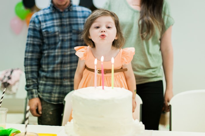 Birthday Girl blowing out her candles from a Tutti Frutti Birthday Party via Kara's Party Ideas | KarasPartyIdeas.com (4)