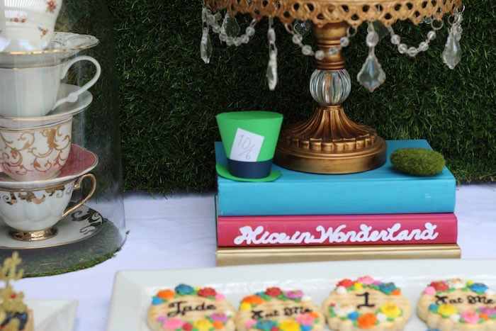 Staked Book and Mad Hatter Cake Stand Prop from an Alice In Wonderland Dessert Table via Kara's Party Ideas | KarasPartyIdeas.com (12)