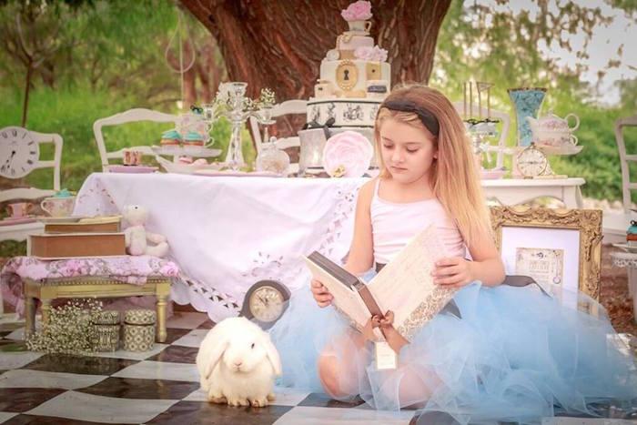 Alice Reading a Storybook from an Alice in Wonderland Tea Party via Kara's Party Ideas   KarasPartyIdeas.com (11)