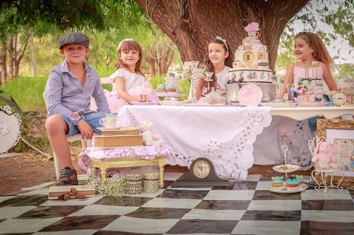 Kids enjoying an Alice in Wonderland Tea Party via Kara's Party Ideas   KarasPartyIdeas.com (5)