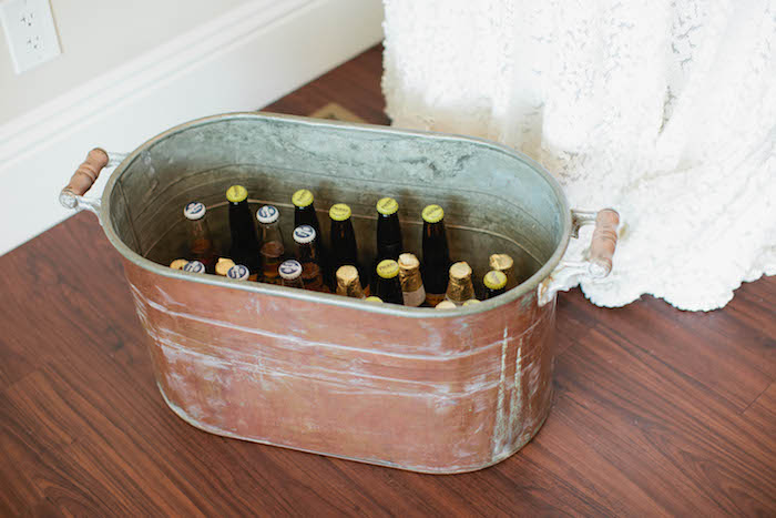 Bottled Drinks placed in a Rustic Bin from a Boho Baby Shower via Kara's Party Ideas | KarasPartyIdeas.com (44)