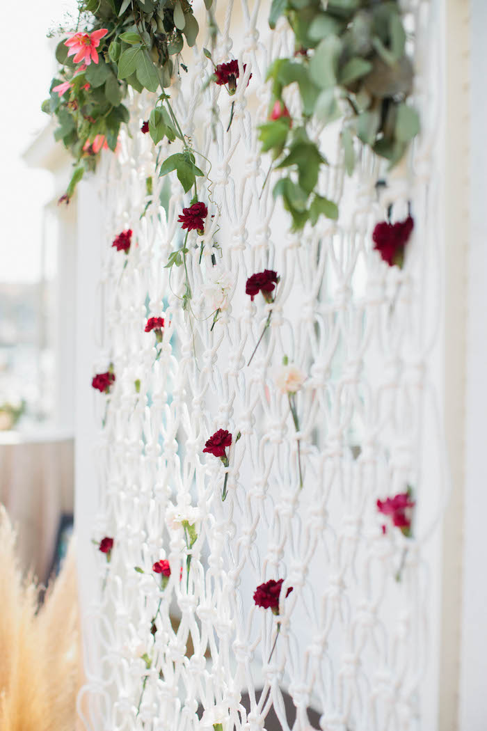 details of a bohemian photo backdrop from a boho baby shower via kara