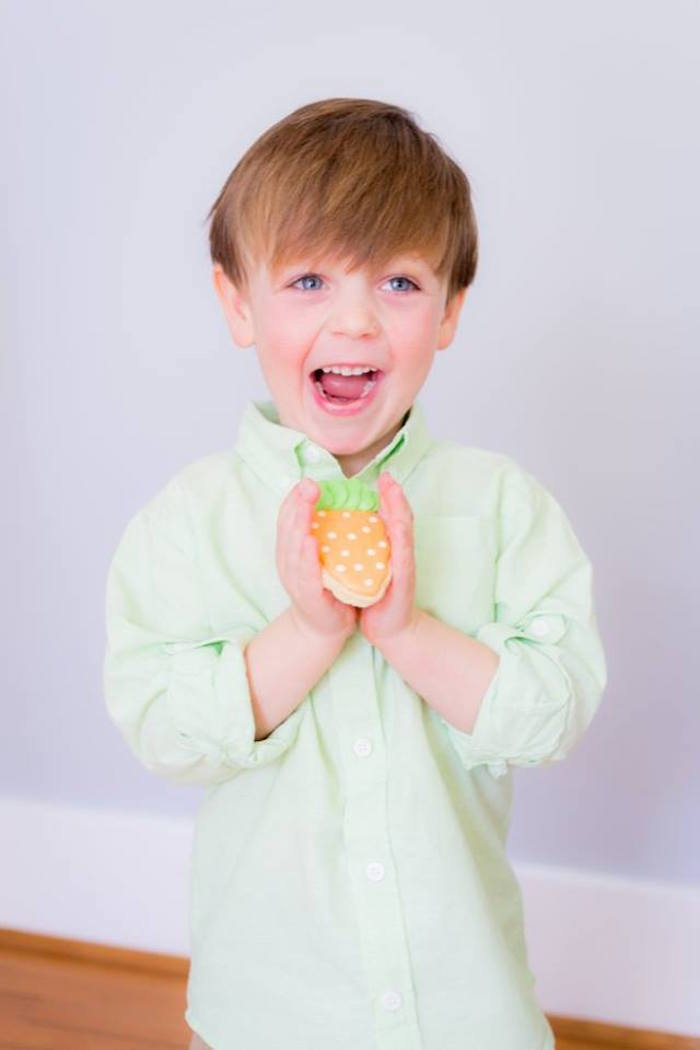 Little Boy with a Carrot Shaped Cookie from an Easter Bunny Brunch via Kara's Party Ideas | KarasPartyIdeas.com (9)