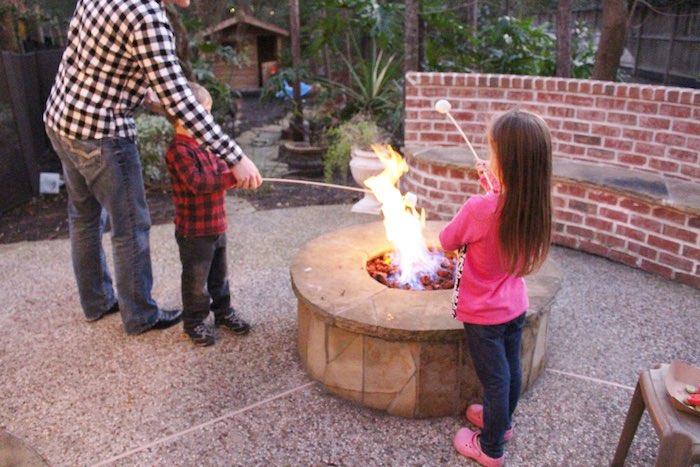 Party Goers Roasting Marshmallows at a Little Lumberjack Birthday Party via Kara's Party Ideas KarasPartyIdeas.com (4)