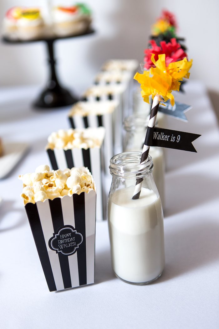 Rows of Popcorn & Drink Bottles filled with Milk from a Modern Justice League Birthday Party via Kara's Party Ideas KarasPartyIdeas.com (41)