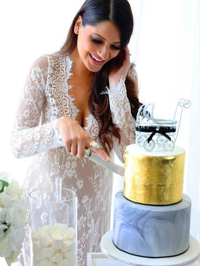 Cutting the Cake from a Modern Marble Baby Shower via Kara's Party Ideas | KARASPARTYIDEAS.COM