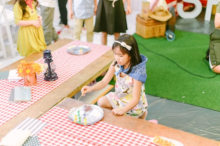 Little Girl playing a Fishing Activity from a Moonrise Kingdom Camping Birthday Party via Kara's Party Ideas | KarasPartyIdeas.com (52)