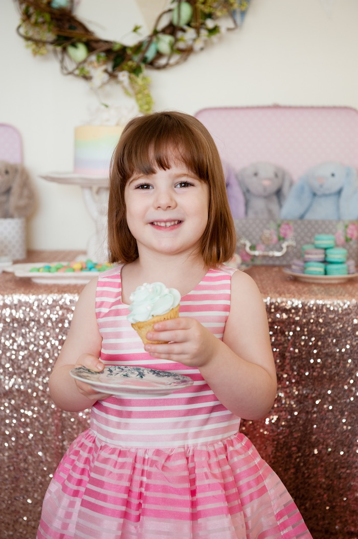 Little girl about to enjoy a cupcake from a Pastel Easter Party via Kara's Party Ideas! KarasPartyIdeas.com (4)