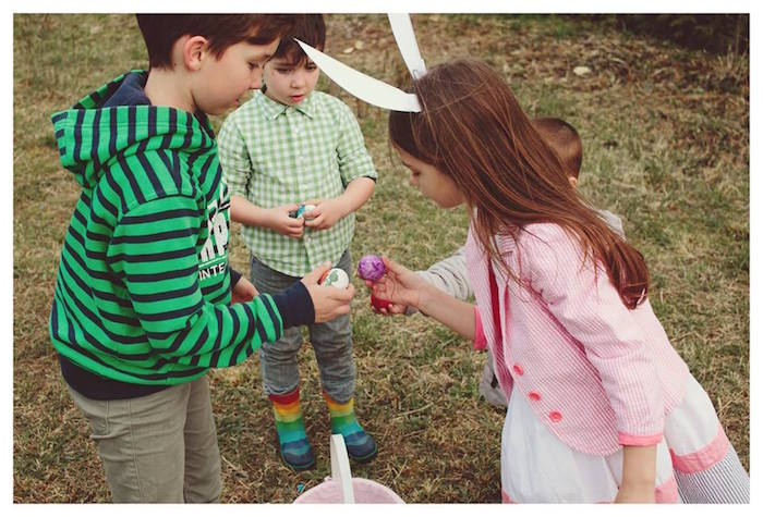 Children with their Easter Eggs from a Spring Easter Brunch Party via Kara's Party Ideas! KarasPartyIdeas.com (9)