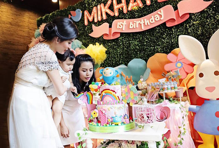 Birthday Girl Blowing out the Candles on her Cake at her Sunny Garden 1st Birthday Party via Kara's Party Ideas | The Place for All Things Party! KarasPartyIdeas.com (5)