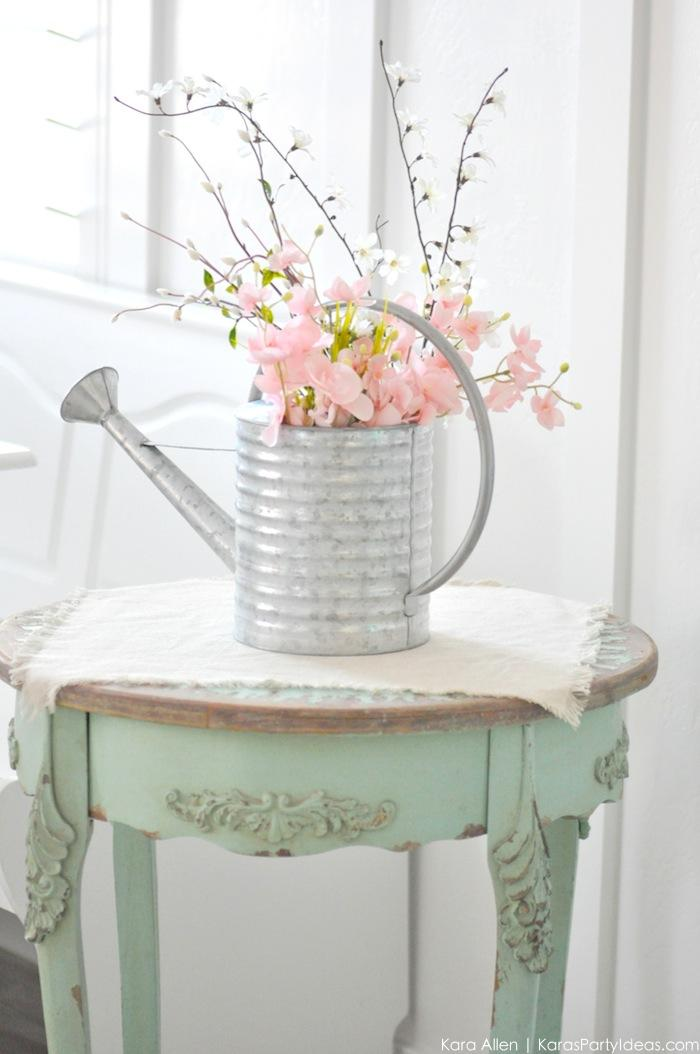 Kara s party ideas spring watering can floral centerpiece