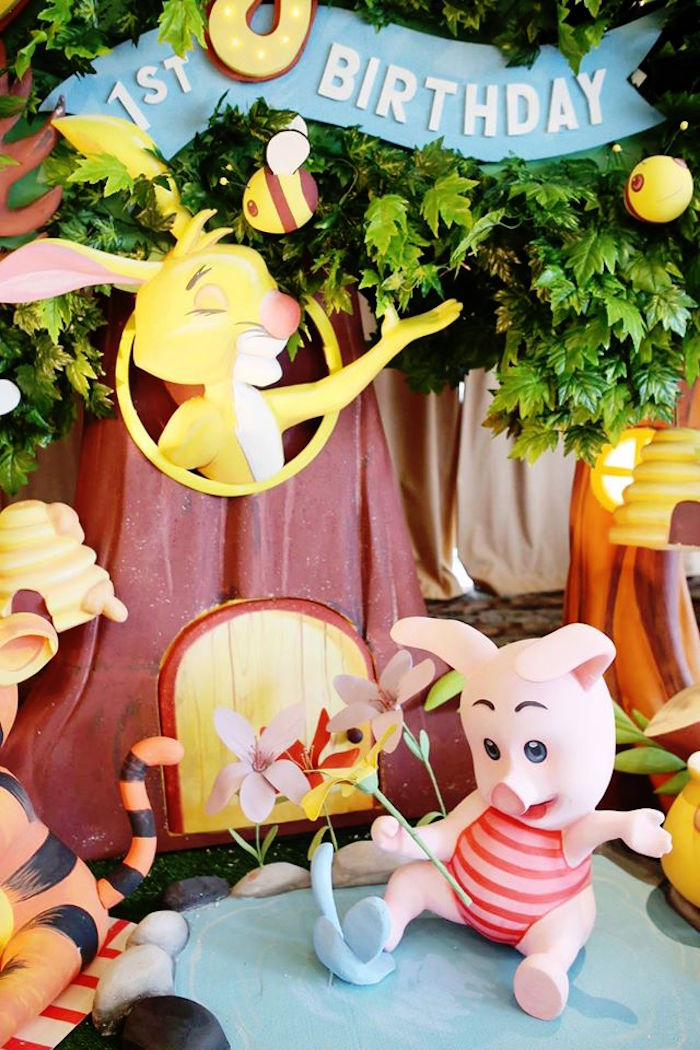 Party Backdrop + Decor from a Winnie the Pooh Themed Birthday Party via  Kara's Party Ideas