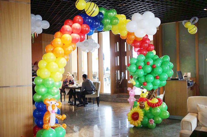 Karas Party Ideas Balloon Arch from a Winnie the Pooh Themed