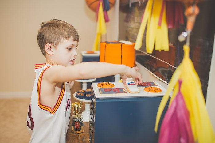Party guest grabbing some sweets from a Basketball Birthday Party via Kara's Party Ideas KarasPartyIdeas.com (24)