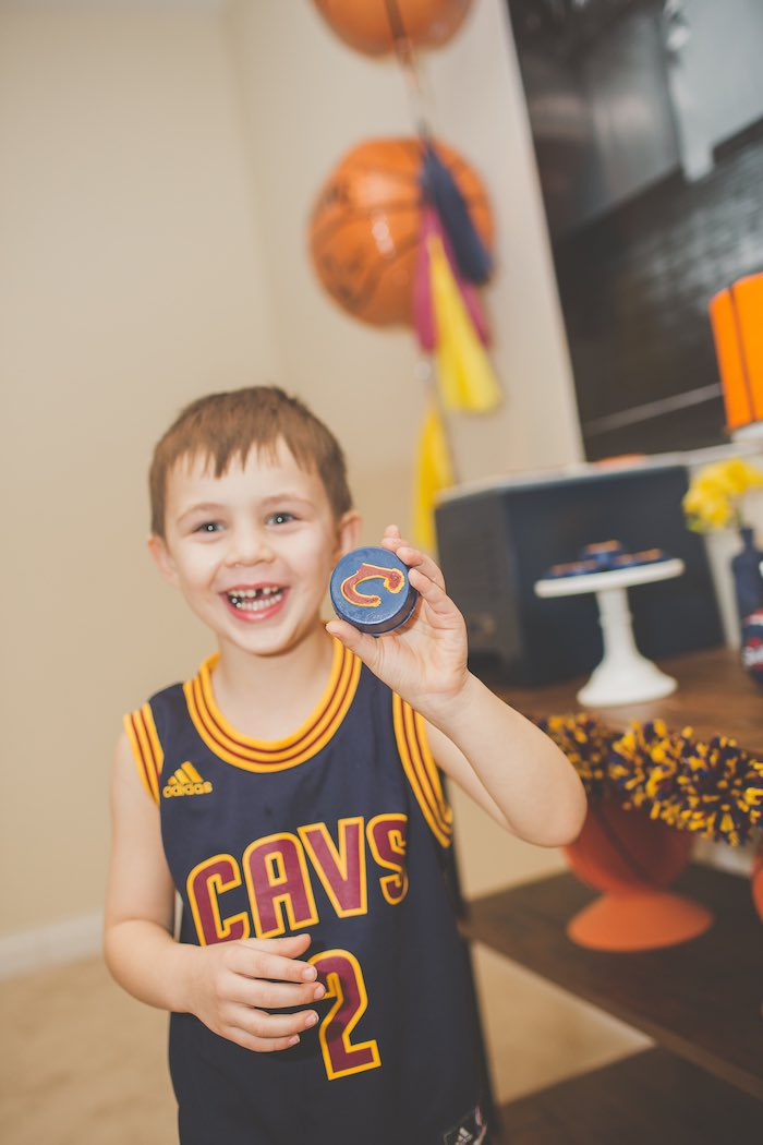 Basketball Player with a Chocolate Covered Oreo in hand from a Basketball Birthday Party via Kara's Party Ideas KarasPartyIdeas.com (33)