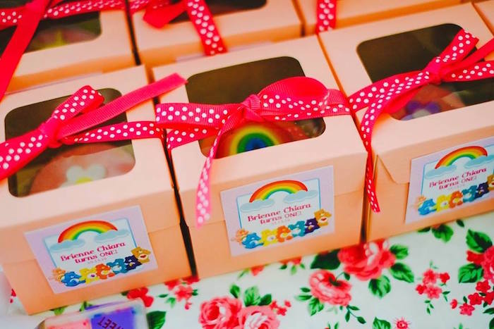 Karas party ideas care bears themed birthday party karas party ideas favor boxes filled with cupcakes from a care bears themed birthday party via karas party ideas filmwisefo