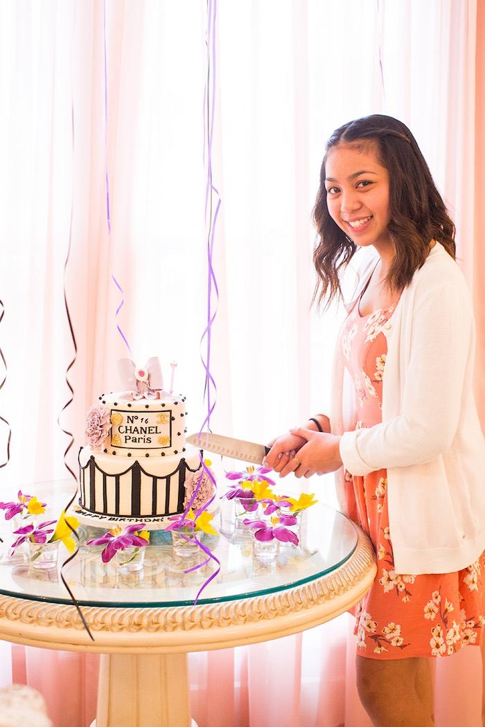 Birthday Girl cutting the Cake from an Elegant Chanel Inspired Birthday Party via Kara's Party Ideas KarasPartyIdeas.com (3)