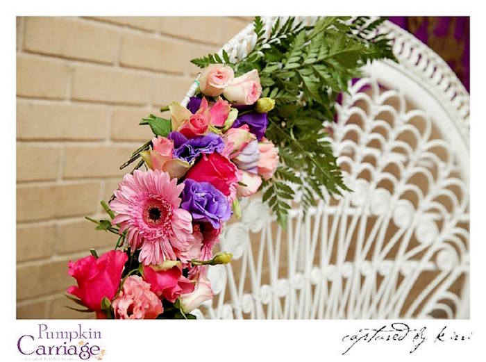 Floral spray placed on a wicker chair from an Elegant Floral Baby Shower via Kara's Party Ideas KarasPartyIdeas.com (22)