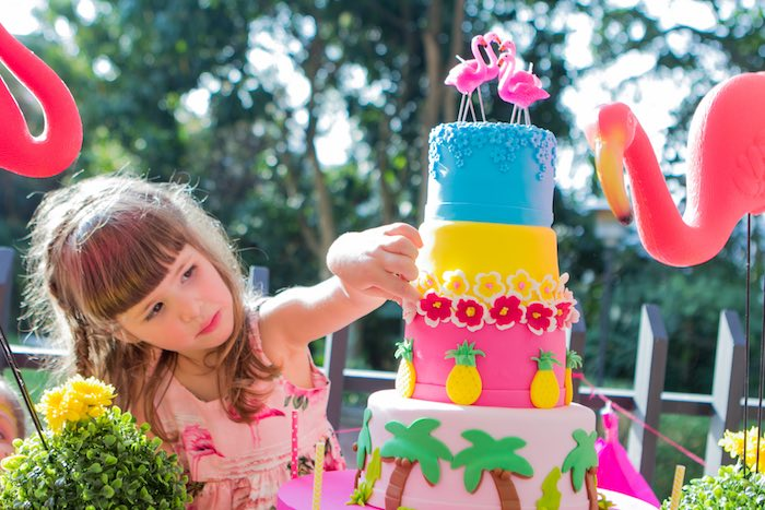 Birthday girl admiring her Cake from a Flamingo Garden Party via Kara's Party Ideas - KarasPartyIdeas.com (30)