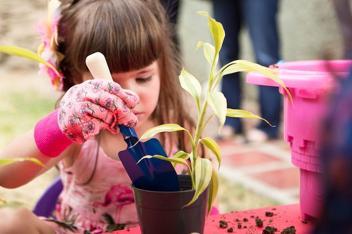 Little Girl at a Gardening Station from a Flamingo Garden Party via Kara's Party Ideas - KarasPartyIdeas.com (8)