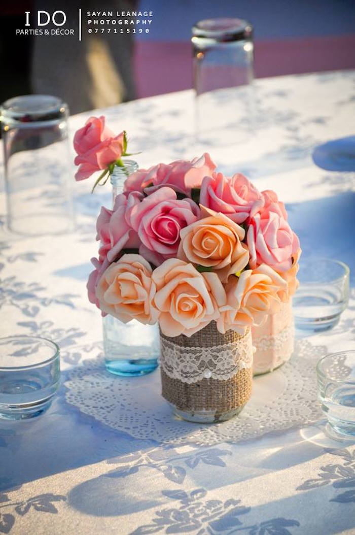 Guest Table Centerpieces Floral Arrangements From A Vintage Shabby Chic 1st Birthday Party Via Karas