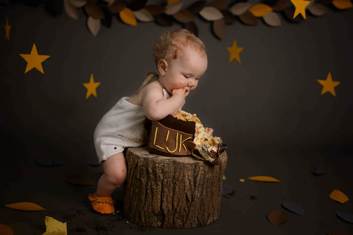 "Little Boy Enjoying his Smash Cake from a ""Wild One"" Where the Wild Things Are Cake Smash + 1st Birthday via Kara's Party Ideas - KarasPartyIdeas.com (4)"