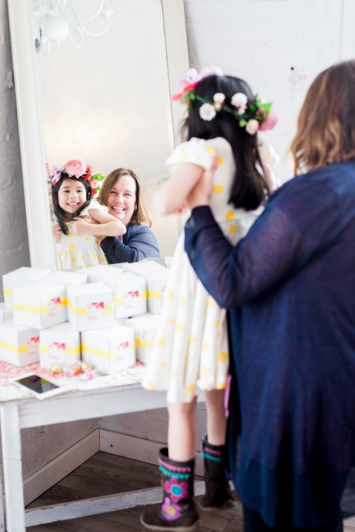 Little girl looking in the mirror at her floral crown from a Flower Crown Crafting Party via Kara's Party Ideas | KarasPartyIdeas.com (28)